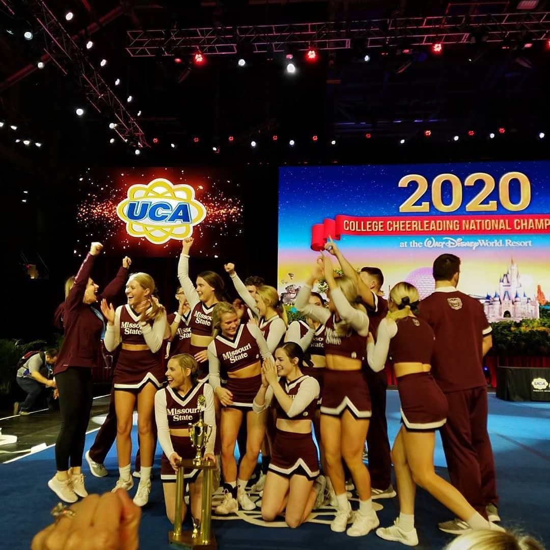 Cheer team with trophy