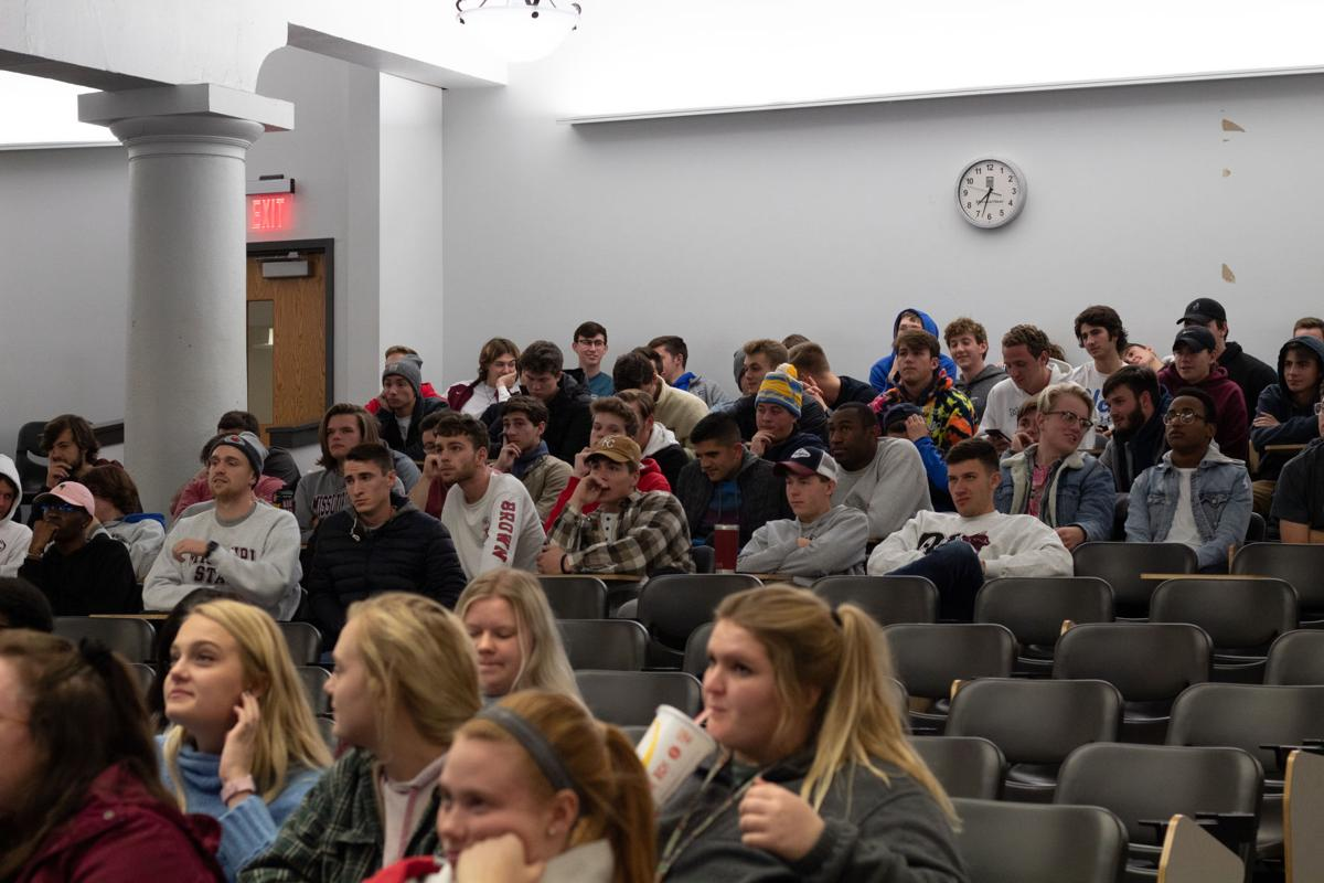 Students listen to a guest speaker during Bear With Us