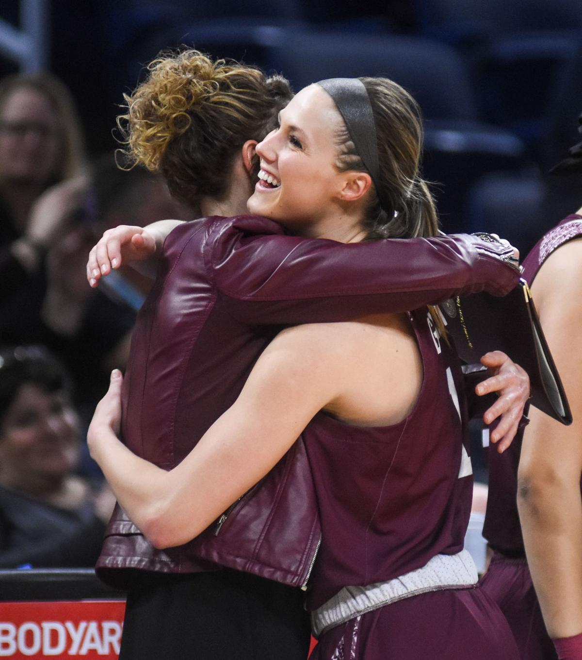 Danielle Gitzen hugs Jackie Stiles