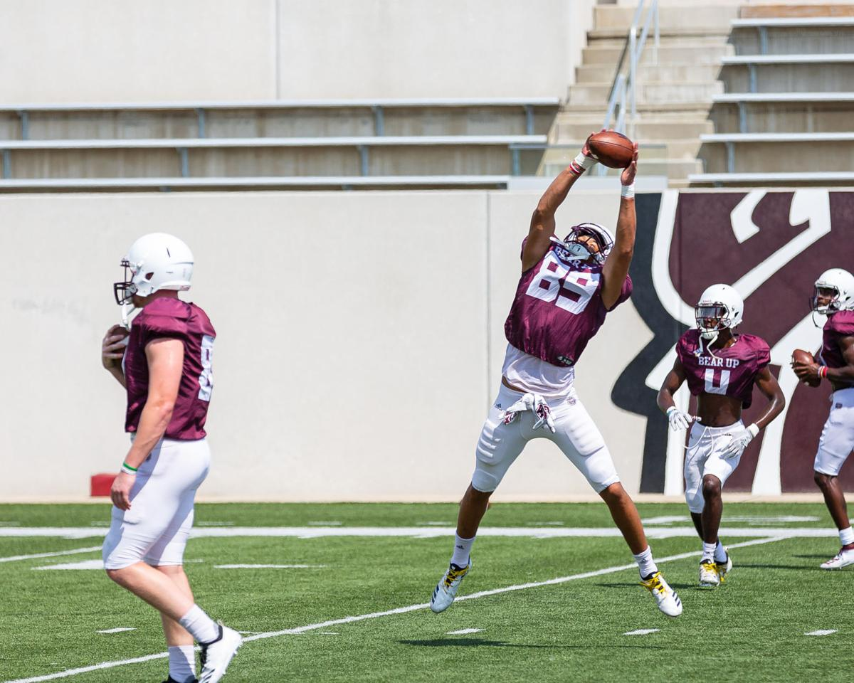 Isaac Smith catches the ball at practice