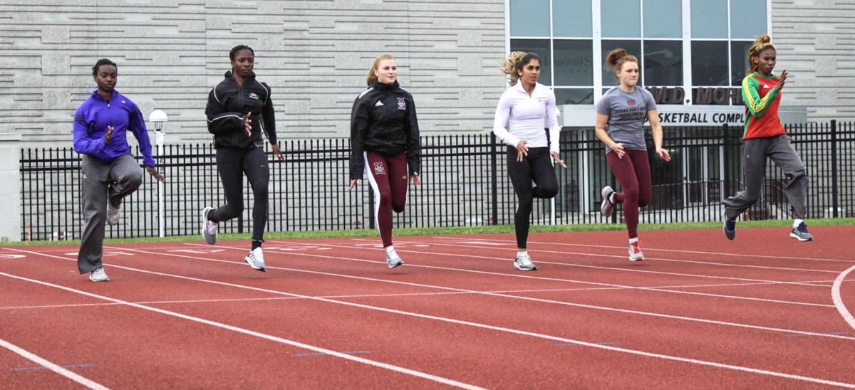 The MSU Bears track team warms up before practice