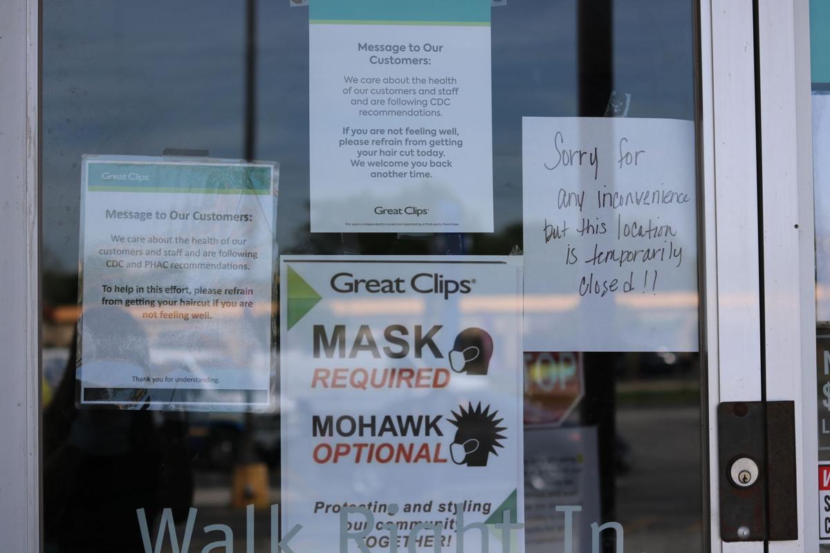 Sign on Great Clips door