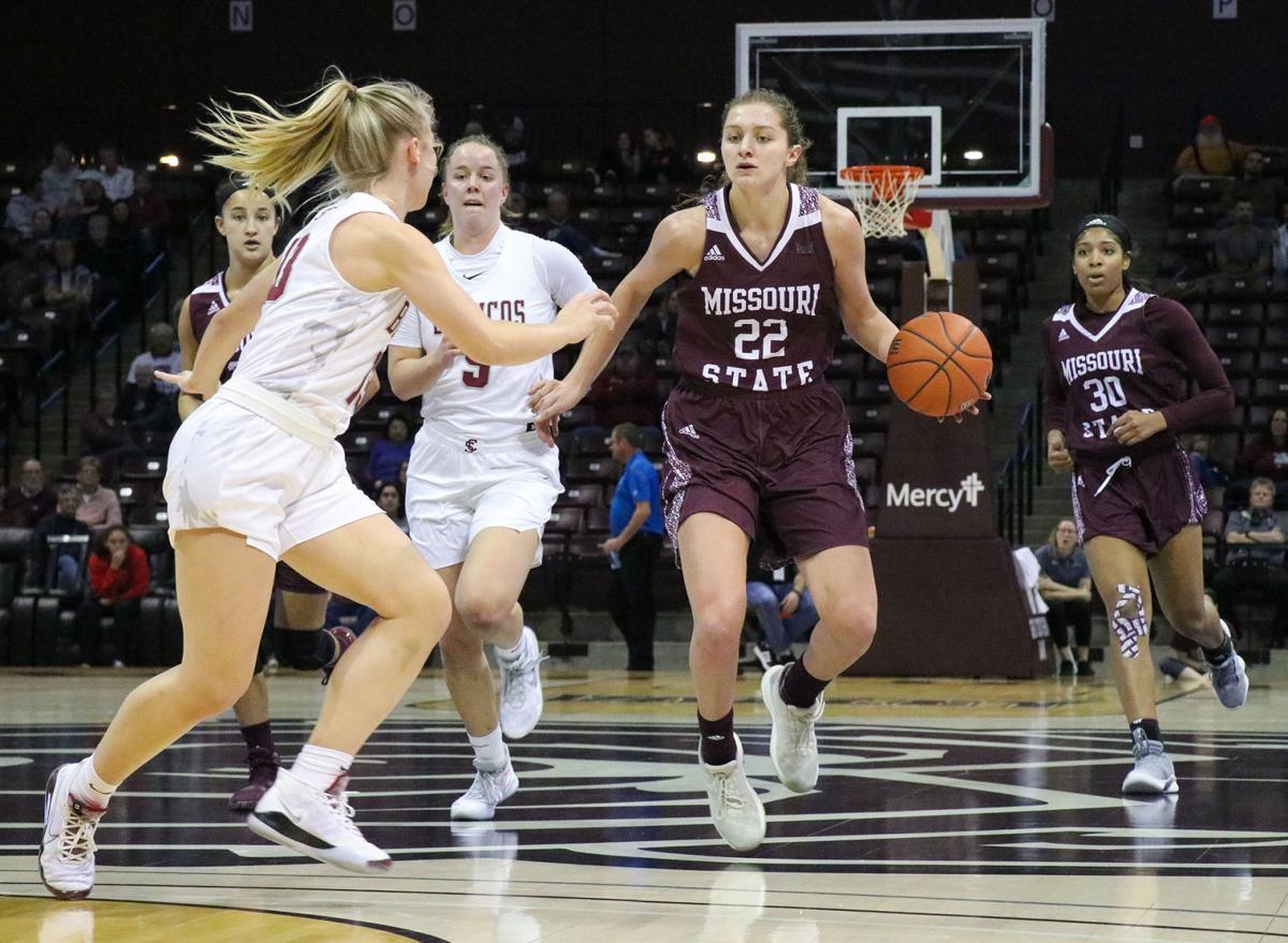 Alexa Willard dribbles the ball