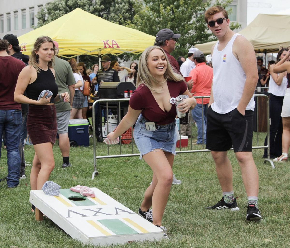 fans play cornhole during the tailgate