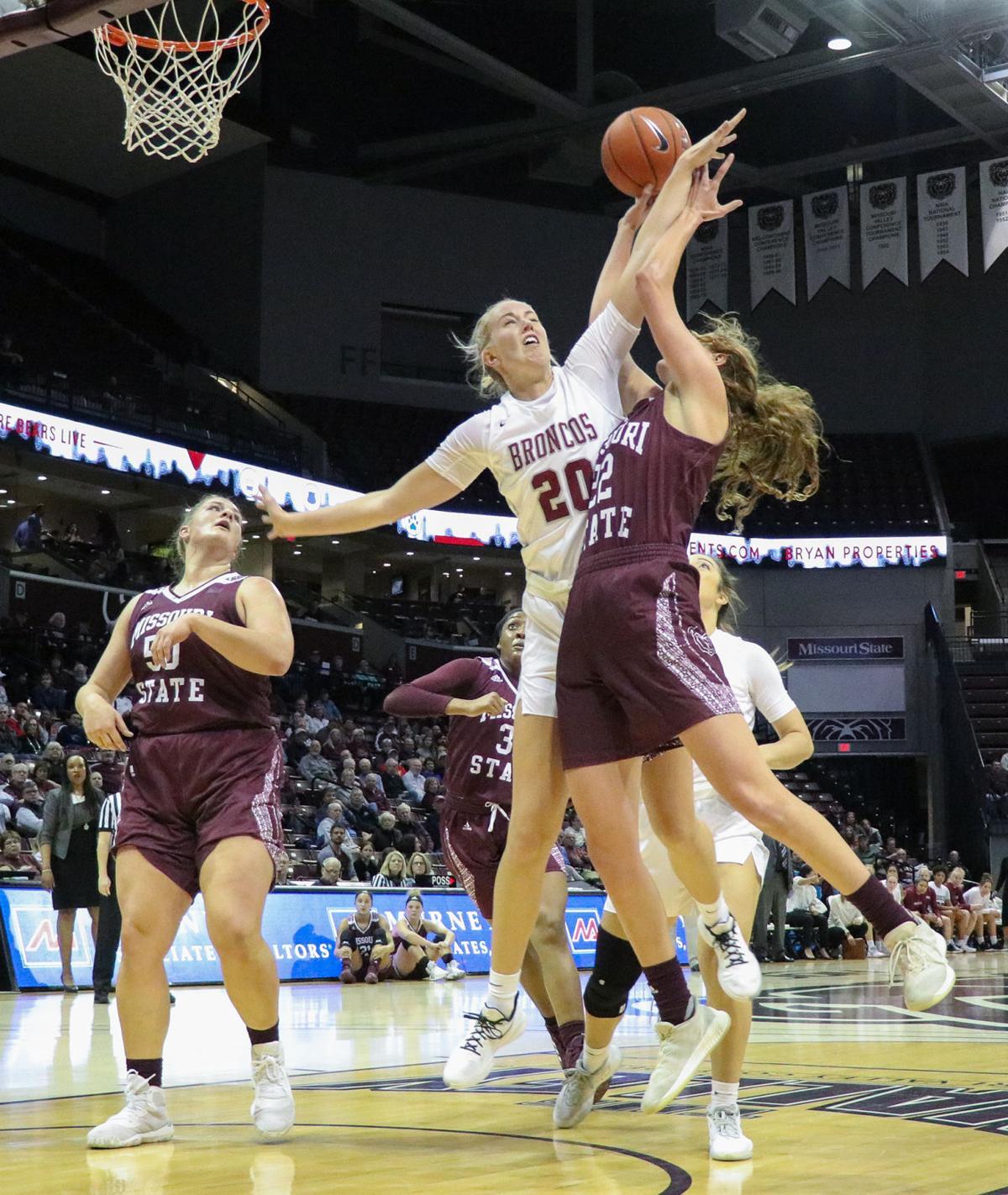 Alexa Willard leaps to throw the ball