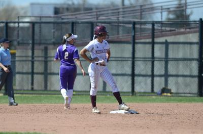 Kyana Mason stands on the base