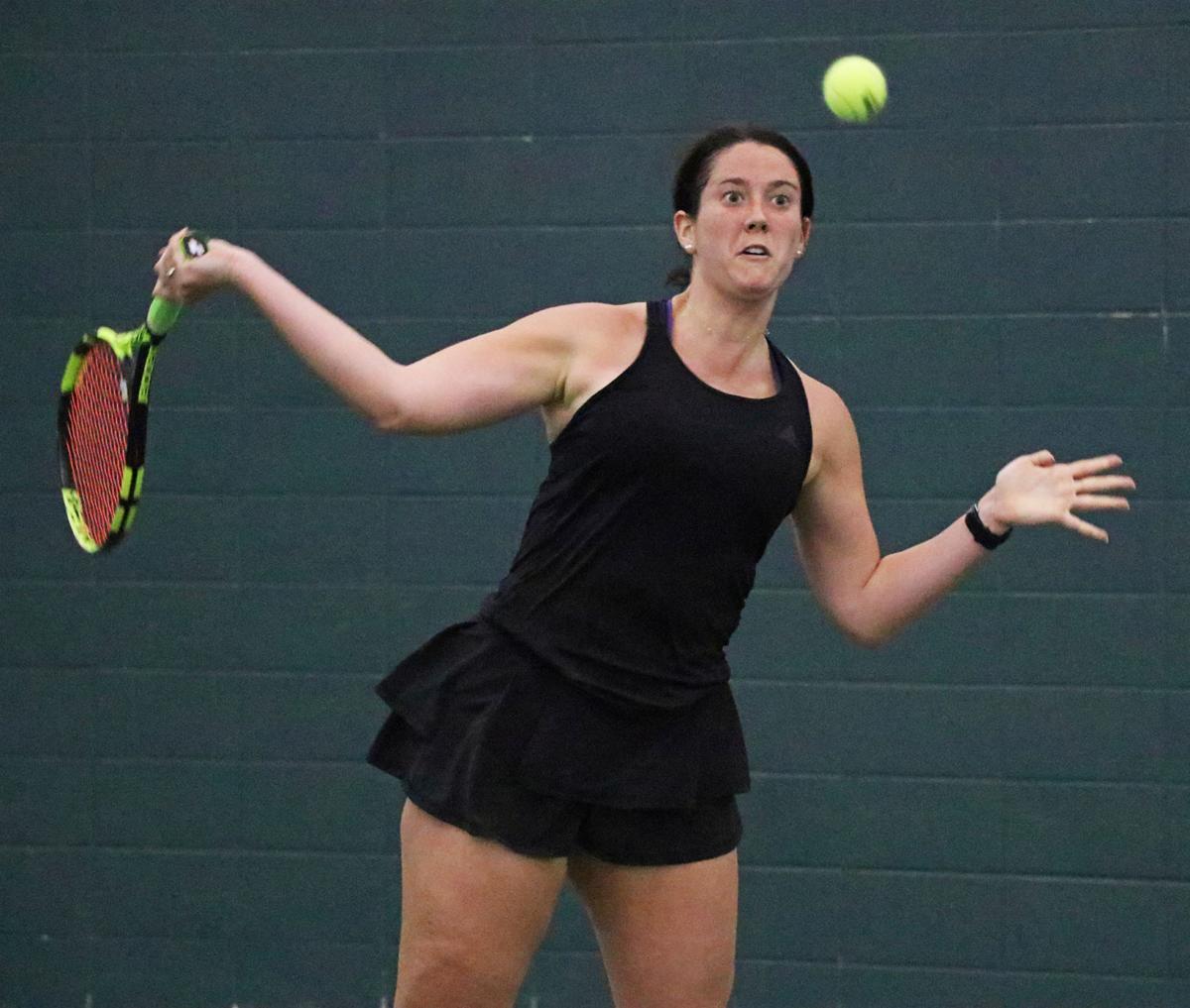 Senior Phoebe Boeschen swings to hit the ball