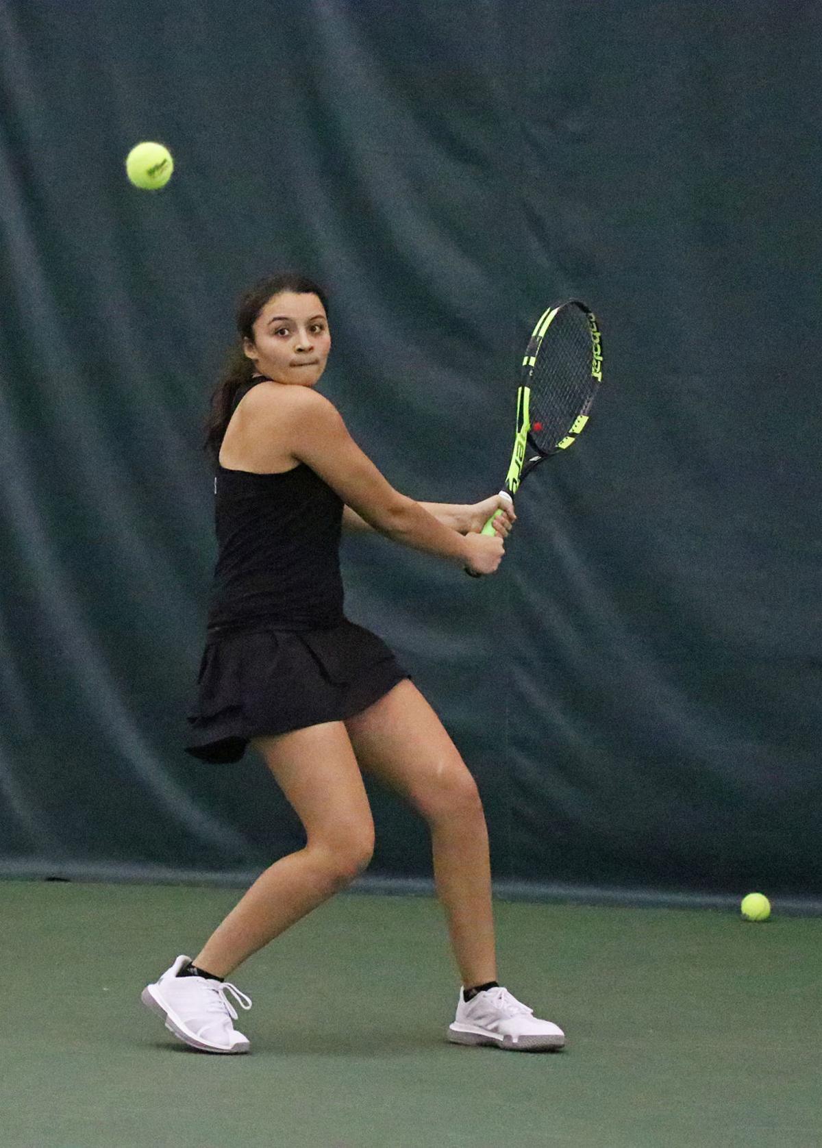 Fati Khamissi swings a backhand
