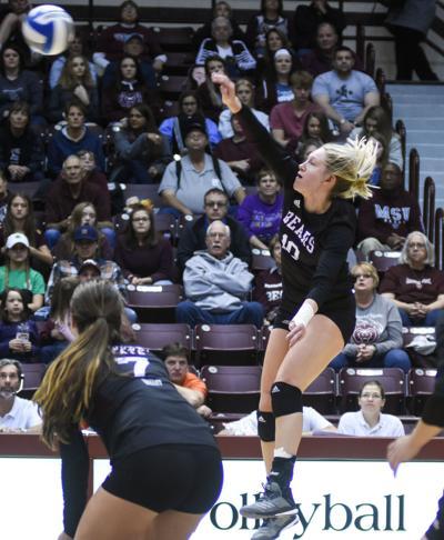 Aubrey Cheffey hits the ball