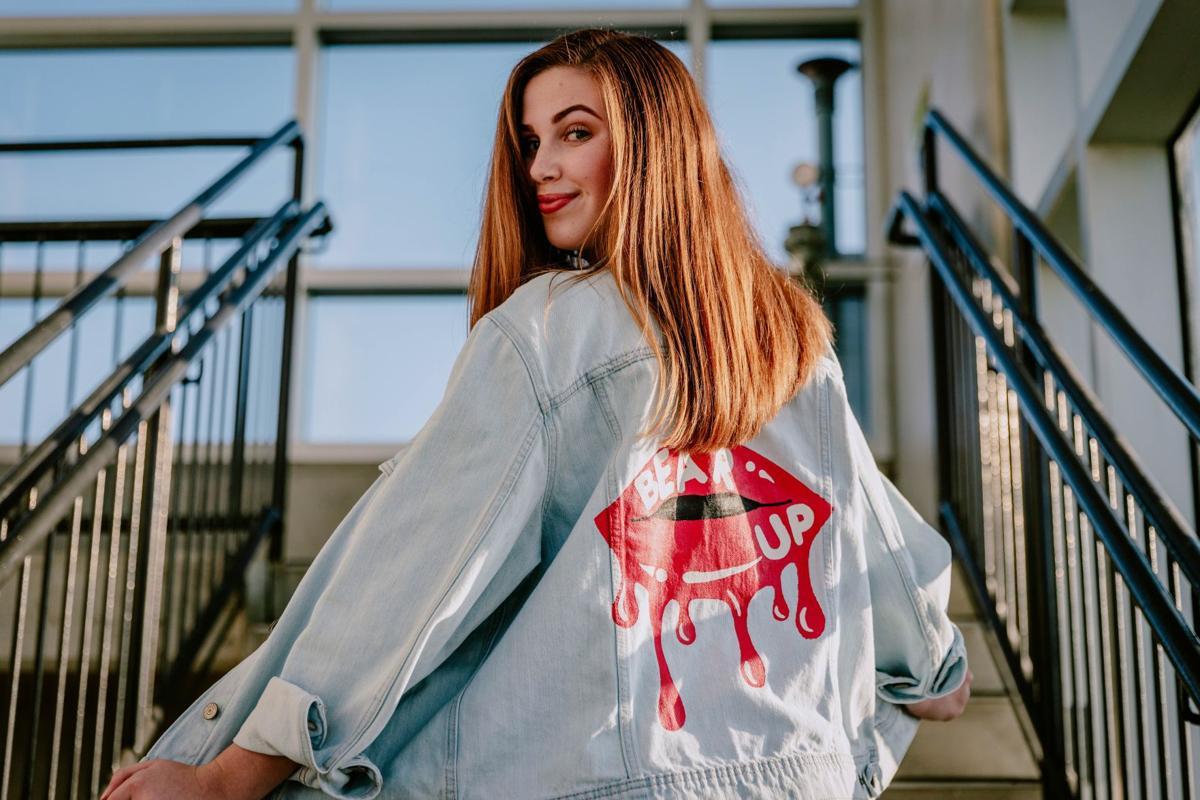 Sarah Kantra models a custom, hand-painted denim jacket