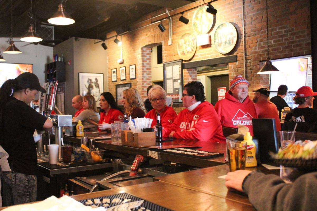 Fans watch the Kansas City Chiefs game at Falstaff's Local