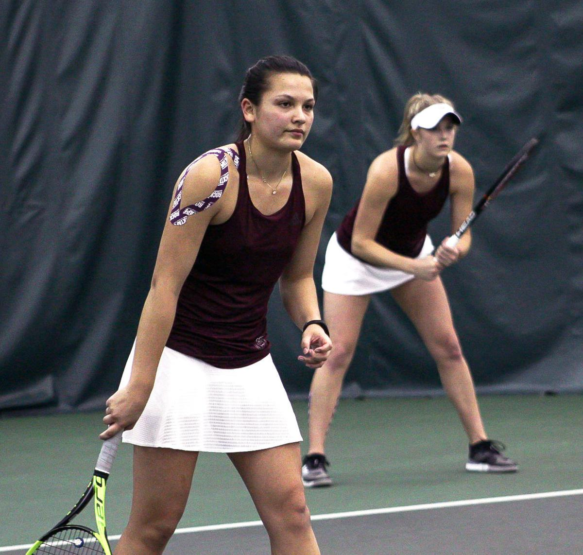 Anna Alons and Ellie Burger prepare to return their opponent's serve