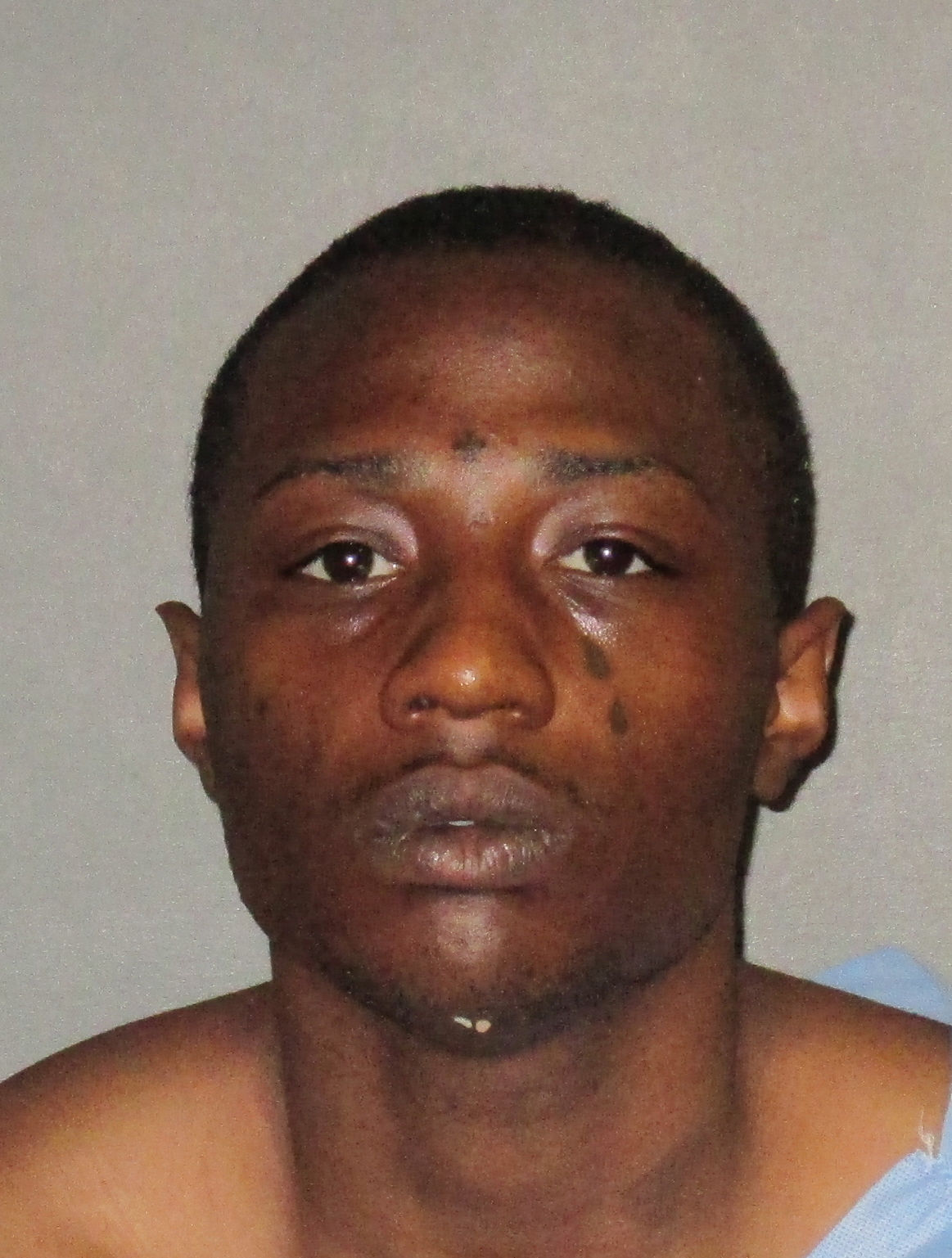 Police: Man arrested after punching out car windows, swinging at police