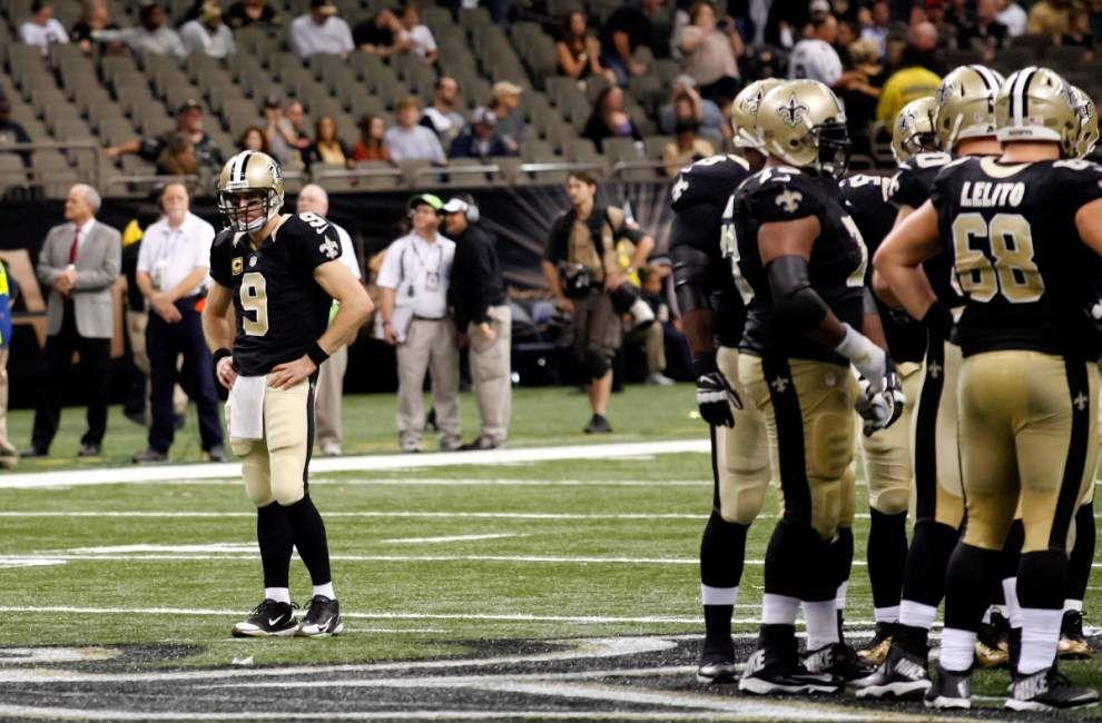 Quarterback Drew Brees participates in open portion of practice Thursday, four Saints sit out _lowres