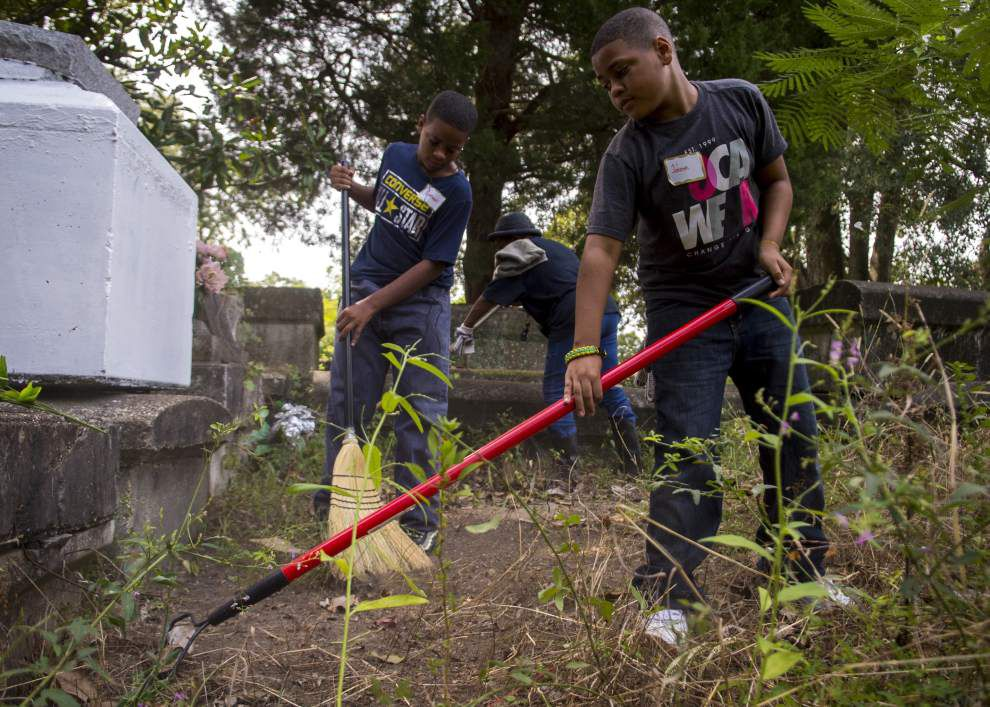 Photos: Volunteers help with cleanup of historic Trinity Lutheran Cemetery _lowres