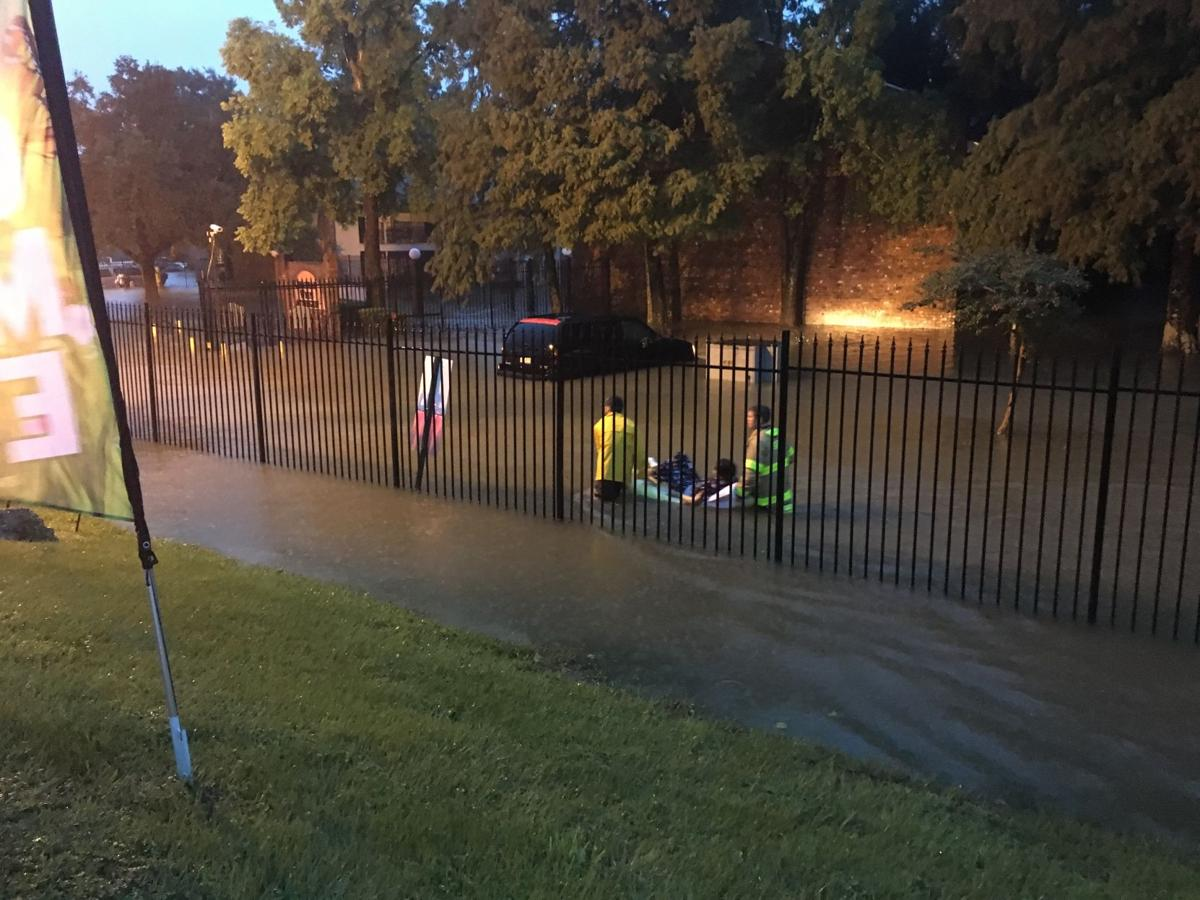 Woman floated out of apartment complex