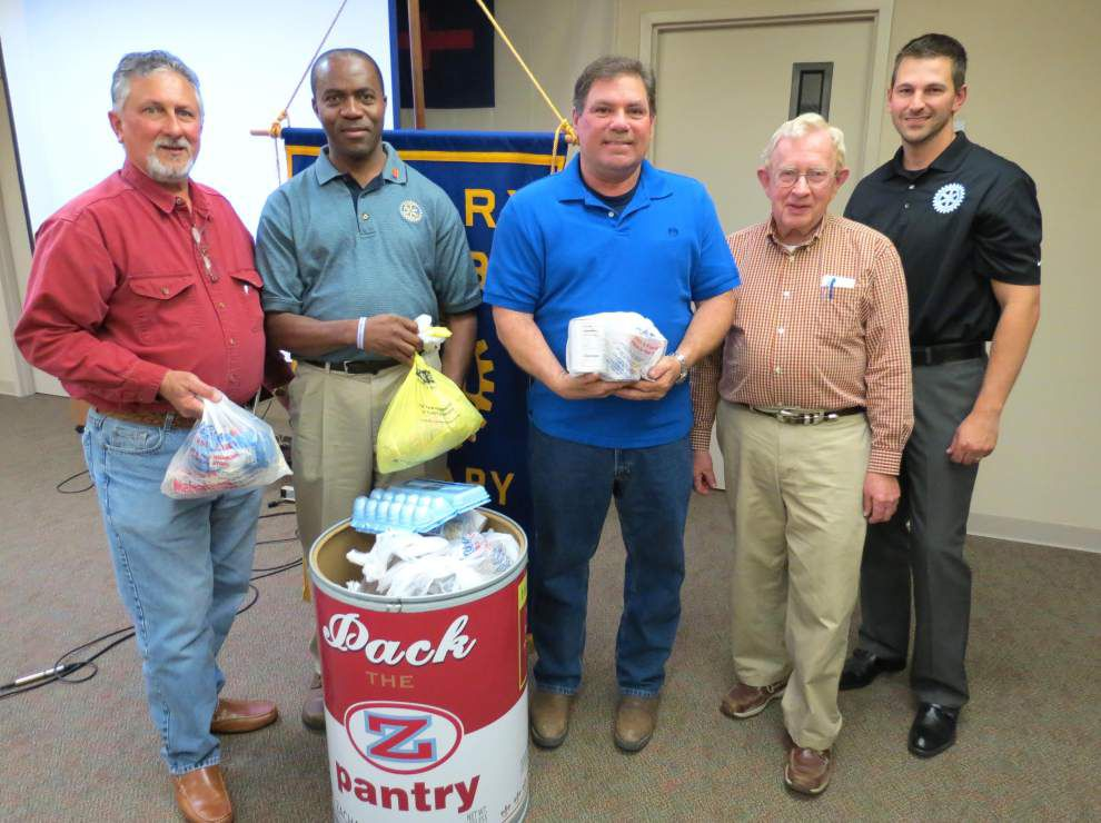 Rotary helps feed hungry families with food drive _lowres