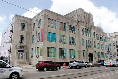What is the history of the art deco building at 727 Carondelet St.?_lowres