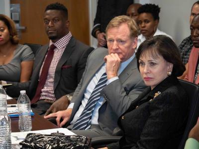 Roger Goodell and Gayle Benson at criminal justice meeting