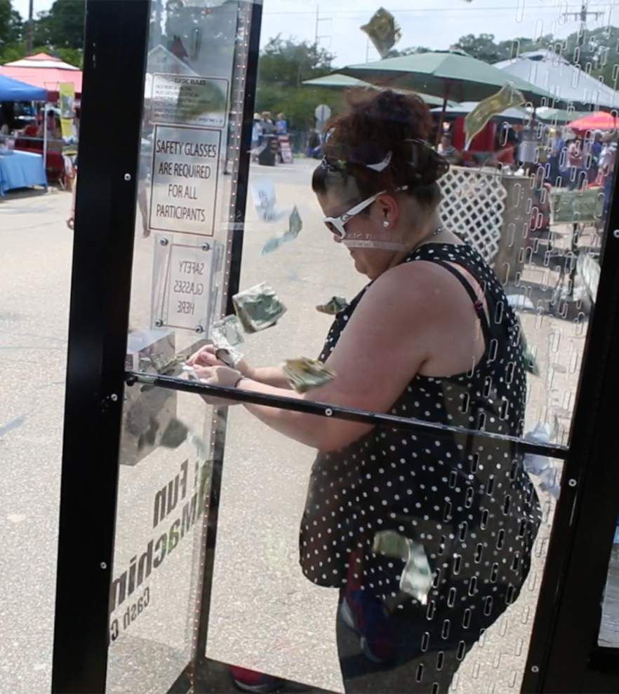 Pelican State Credit Union hosts festival's money booth _lowres