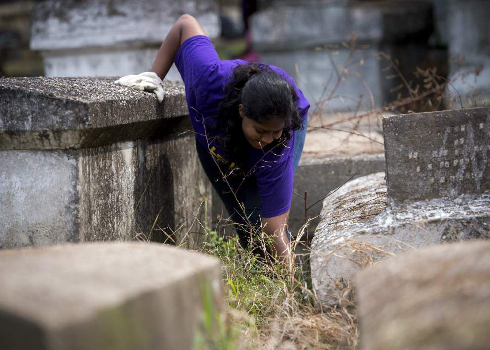 Volunteers spruce up historic Lutheran cemetery _lowres