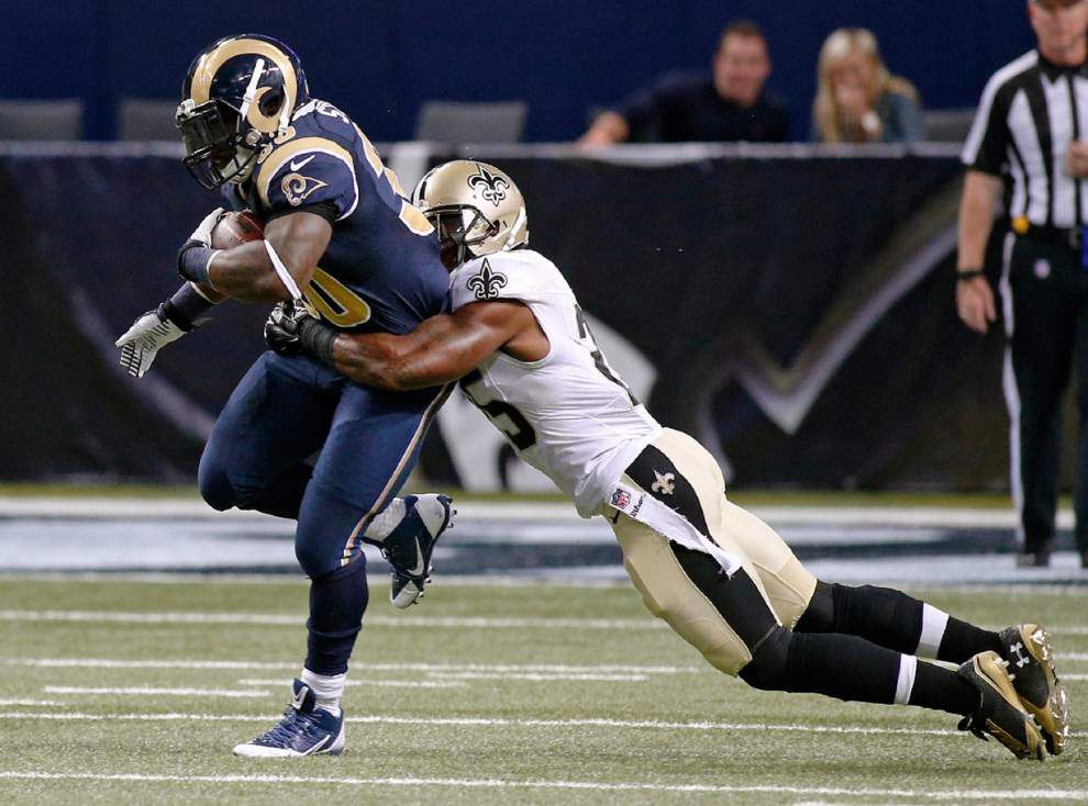 Saints first-team defense struggles early, then slows down Rams _lowres