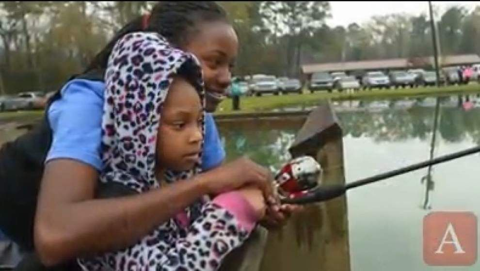 Kiwanis hosts Big Buddy youth in annual fishing event _lowres