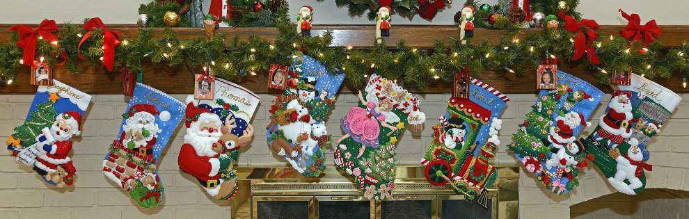 Woman sews colorful stockings for family members as a Christmas tradition _lowres