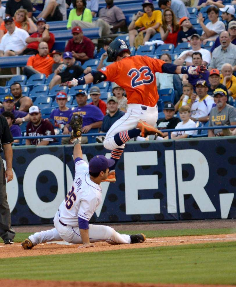 LSU rallies from five runs down — twice — to claim 9-8 win over Auburn in SEC tournament opener _lowres
