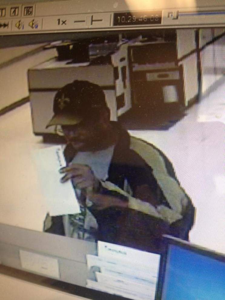 Apparent Saints fan robs Rouses Supermarket bank branch at gunpoint Thursday in New Orleans _lowres