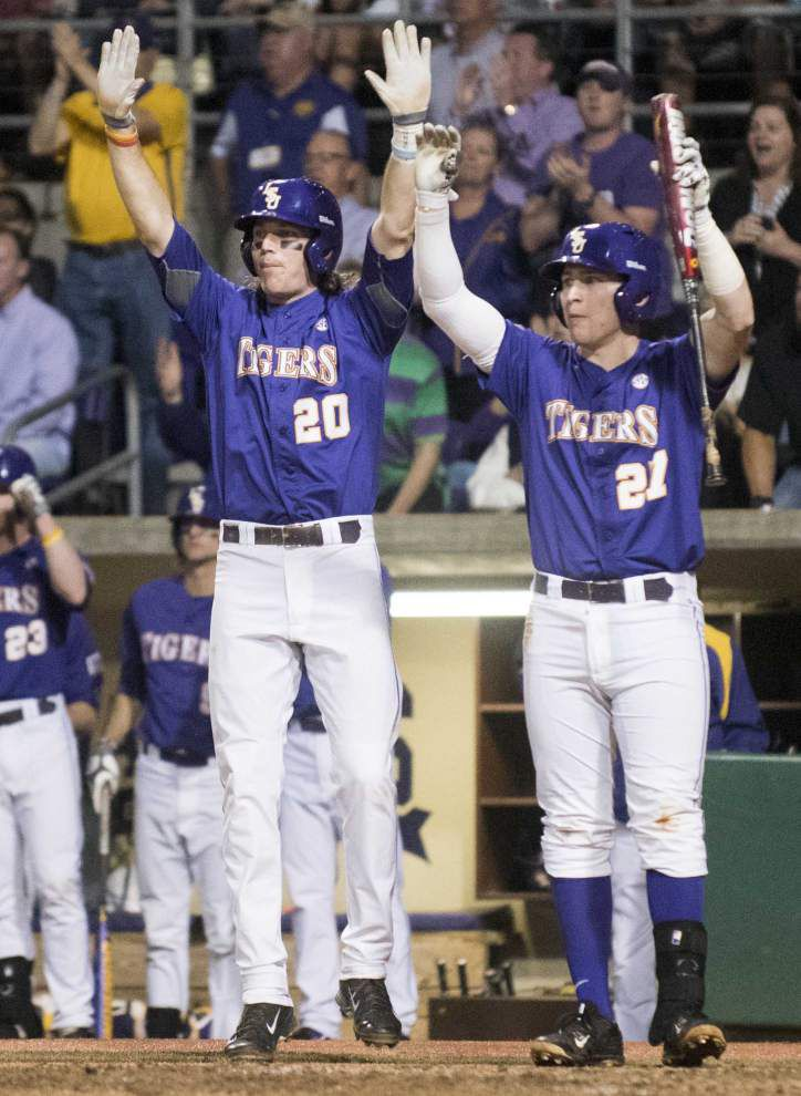 Ole Miss rallies past LSU 5-3 in 14 innings to end Tigers' 14-game winning streak _lowres