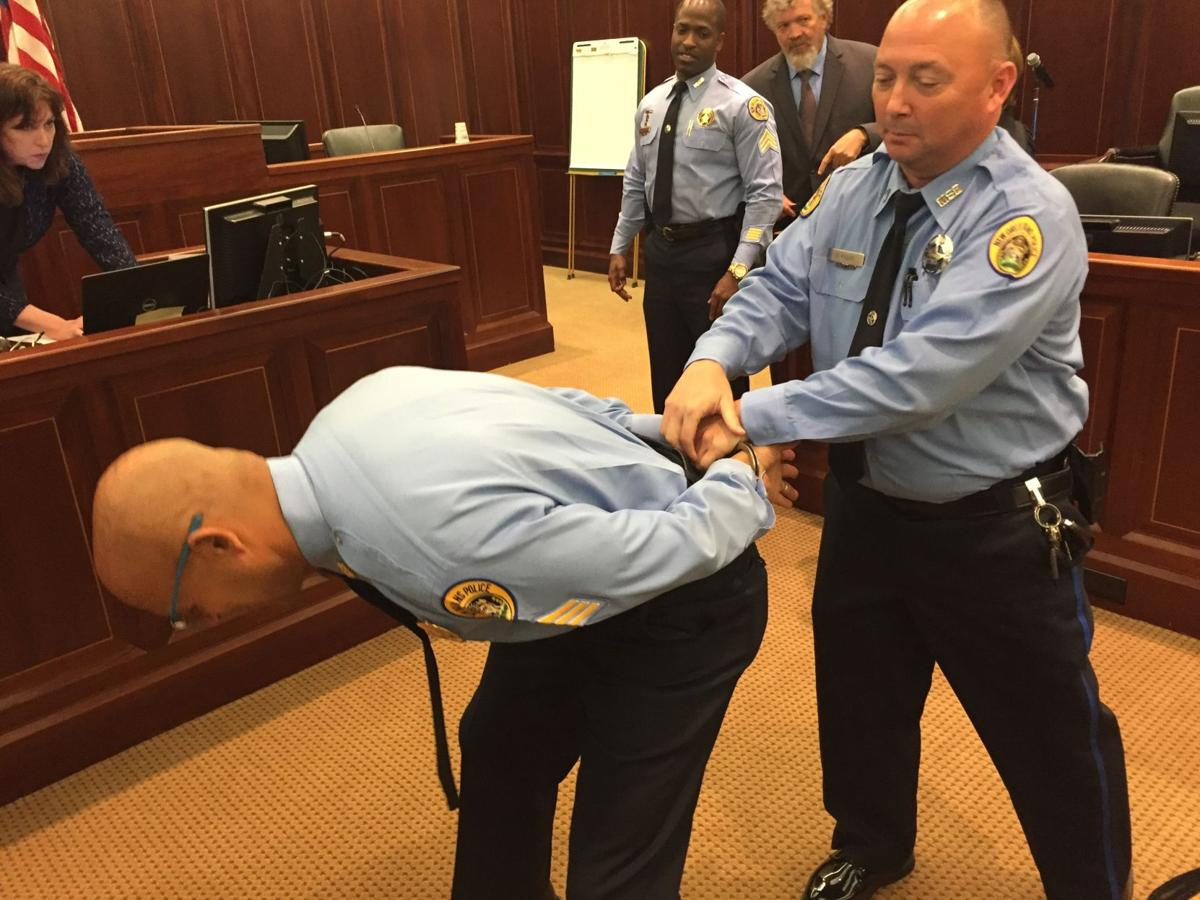 NOPD officers demonstrate handcuffing technique