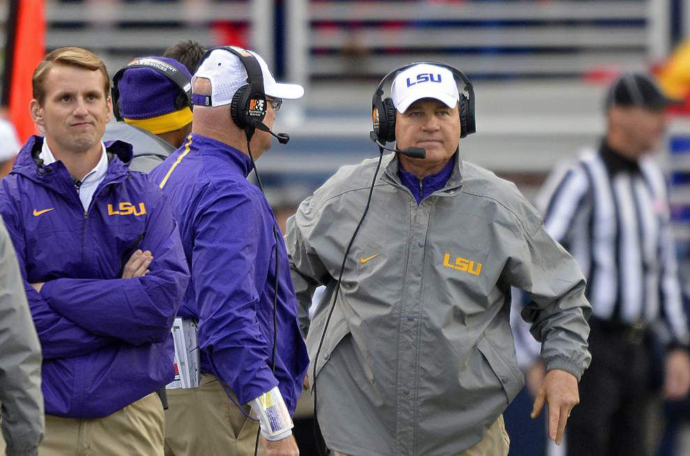 Embattled LSU coach Les Miles conducting business as usual, hasn't met with LSU officials or been told about his job status, source says _lowres
