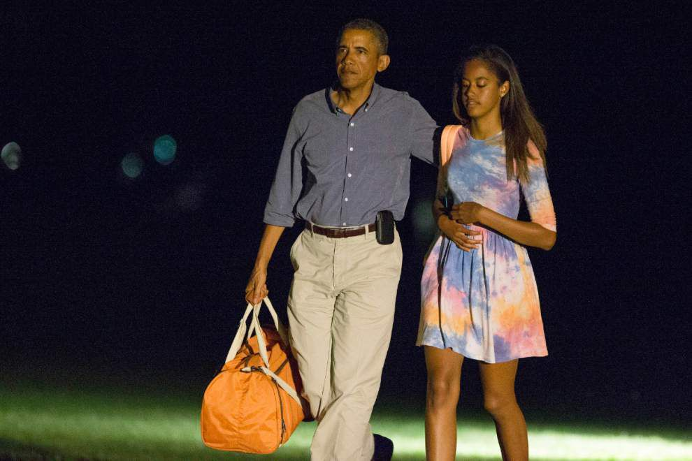 Obama back in Washington on rare vacation break _lowres