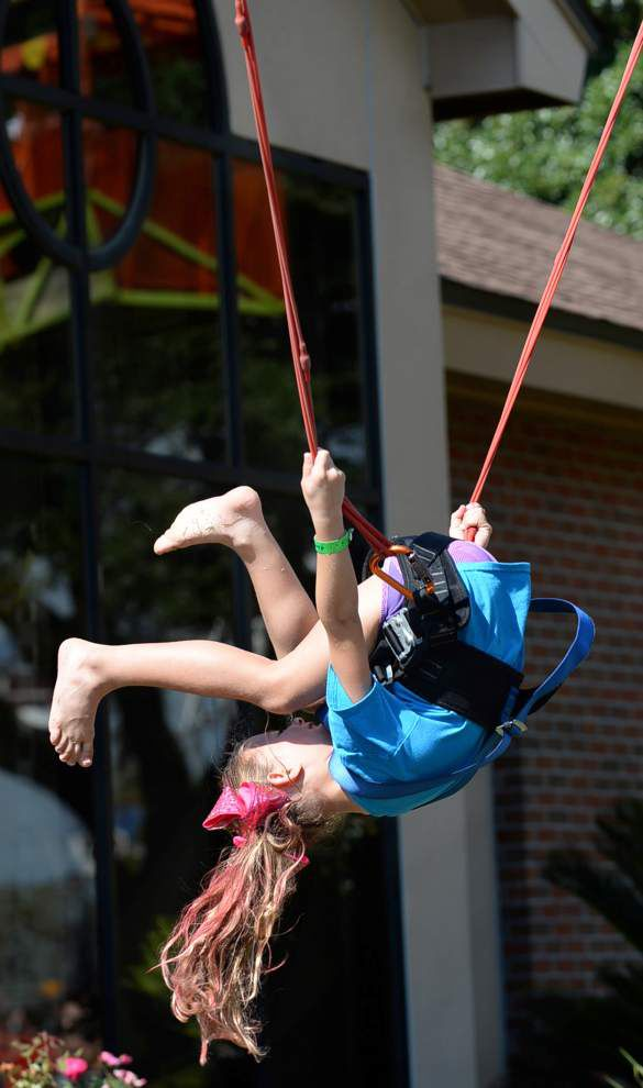 Flying horses, sliding dads, rolling dragons at St. George Fair _lowres