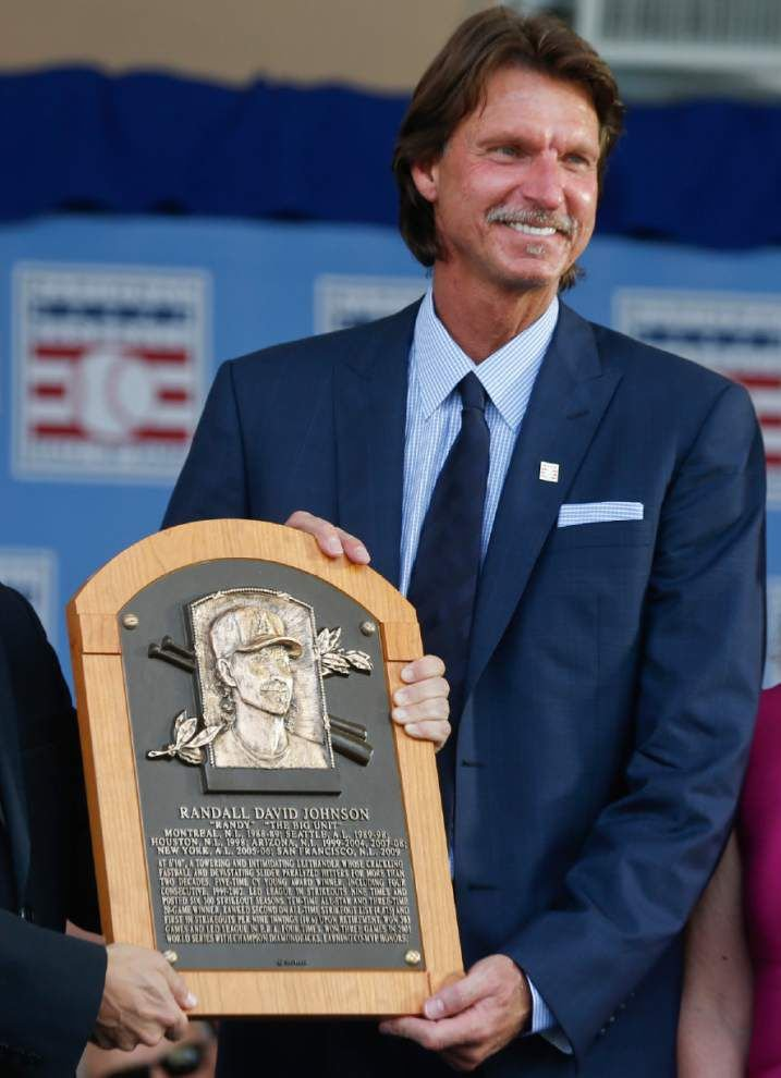 Pedro Martinez honors his Dominican heritage as he, Randy Johnson, John Smoltz and Craig Biggio enter baseball's Hall of Fame together _lowres