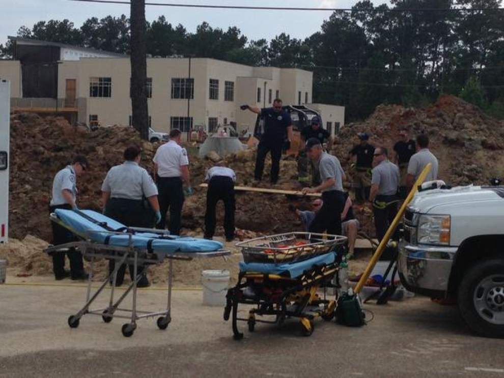 Video, photos: Man dead, another rescued after trench collapses in Covington _lowres