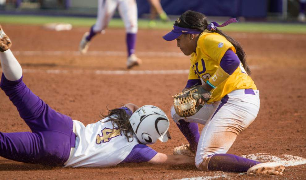 Les East: LSU softball team was tested by up-and-coming James Madison, but the Tigers' advanced program was able to survive and advance _lowres