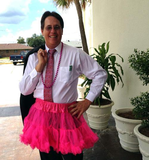 West Bank Spotlight: HCIA officials don pink boas and tutu for challenge _lowres