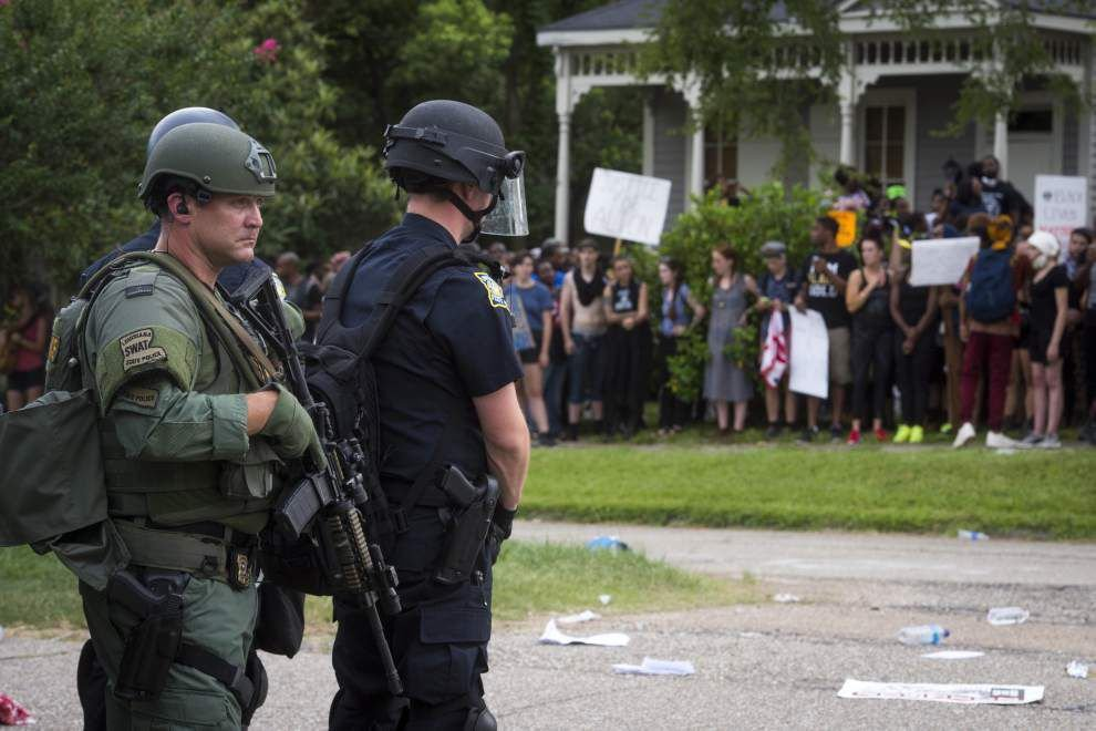Video: Intense scene at Alton Sterling protest in Baton Rouge as officers charge protesters in woman's front lawn _lowres