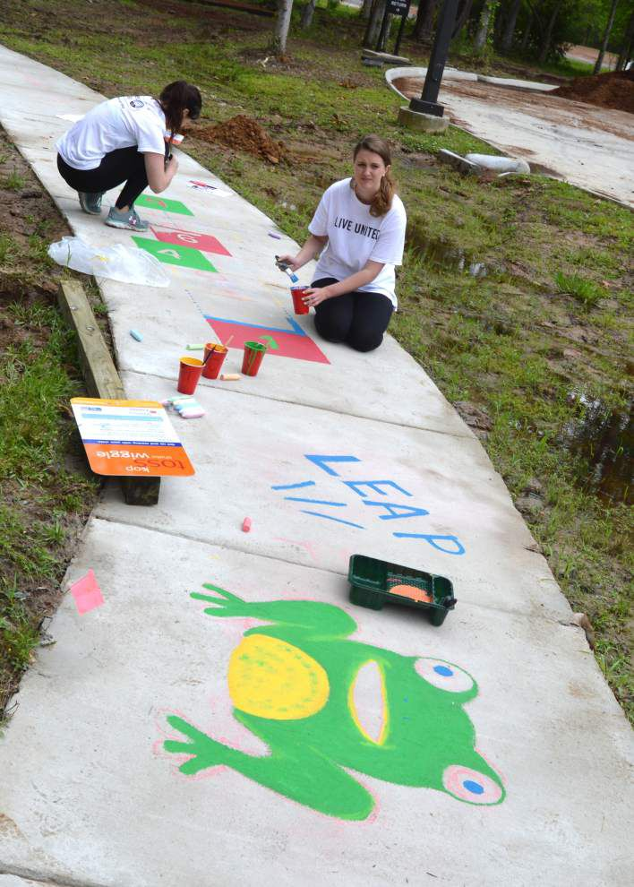Capital Area United Way's Emerging Leaders install Born Learn Trail outside West Feliciana library _lowres