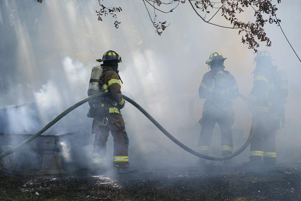 House fire spreads to two other houses on East Johnson Street _lowres