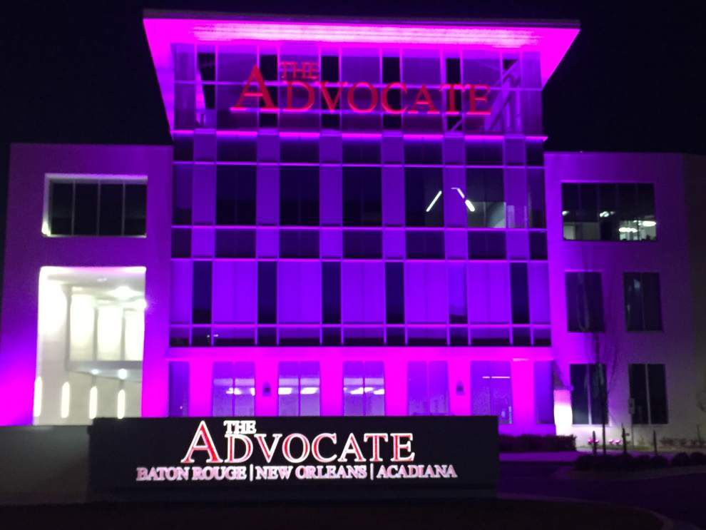 Pretty in pink! Advocate building changes colors to celebrate Spanish Town parade _lowres