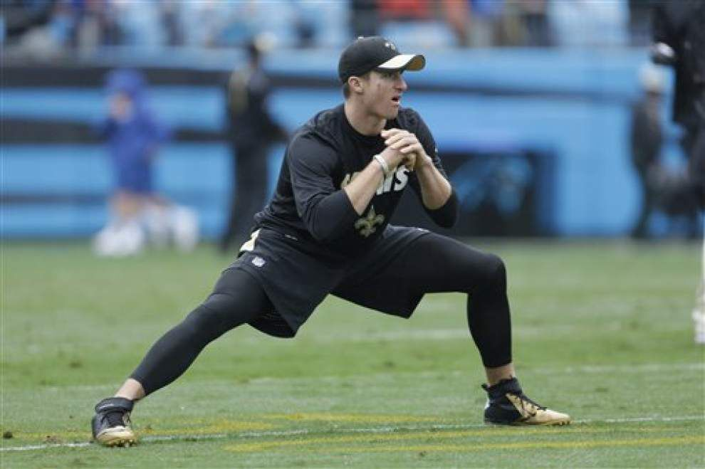 Saints quarterback Drew Brees tells CSTV he remains day to day; says backup Luke McCown 'played great' against Carolina _lowres