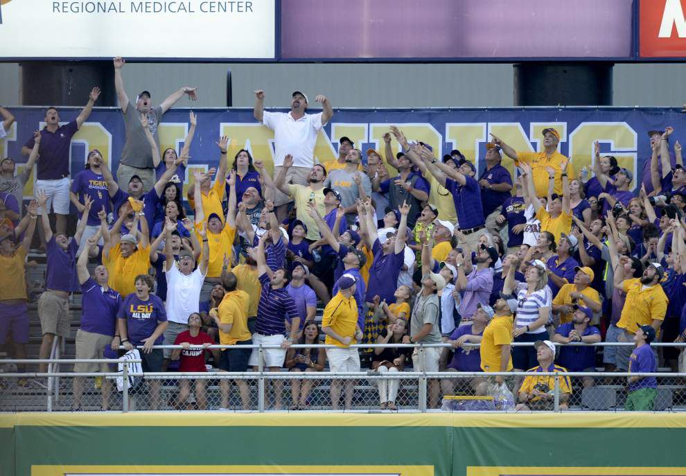 Photos: Revisit big plays, excited fans, high fives, (and an Elvis sighting) as LSU captures Baton Rouge super regional, returns to Omaha _lowres
