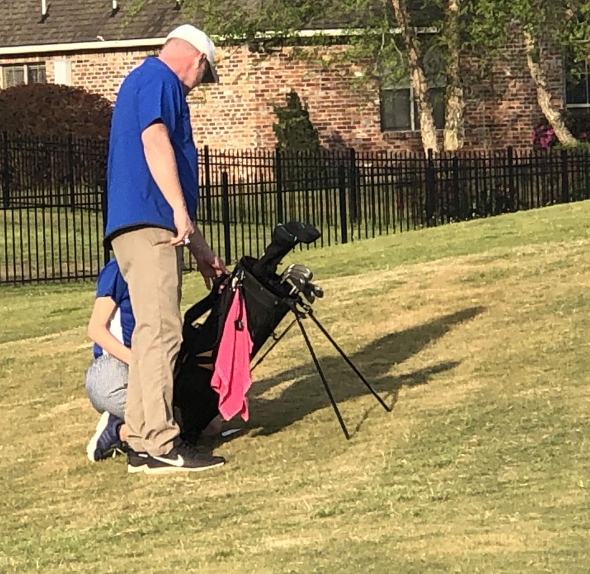 Golf Coach Robb Odom provides instruction to golfer Margare.jpg