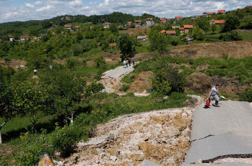 Bosnia flooding triggers landslides, unearth mines _lowres