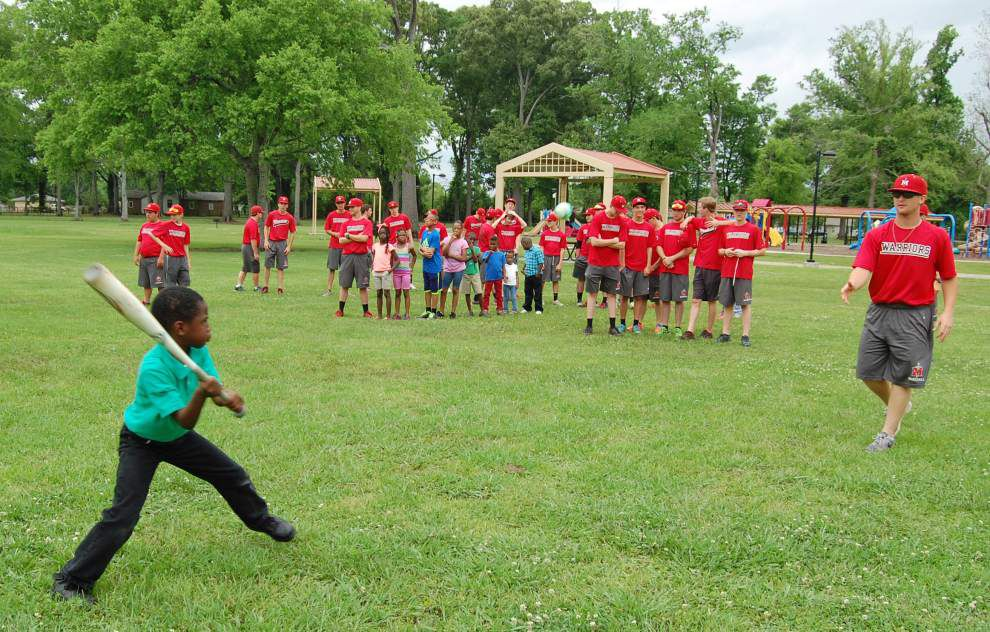 Churches spread the word through sports, teaching area children how to play baseball, football, soccer, basketball _lowres