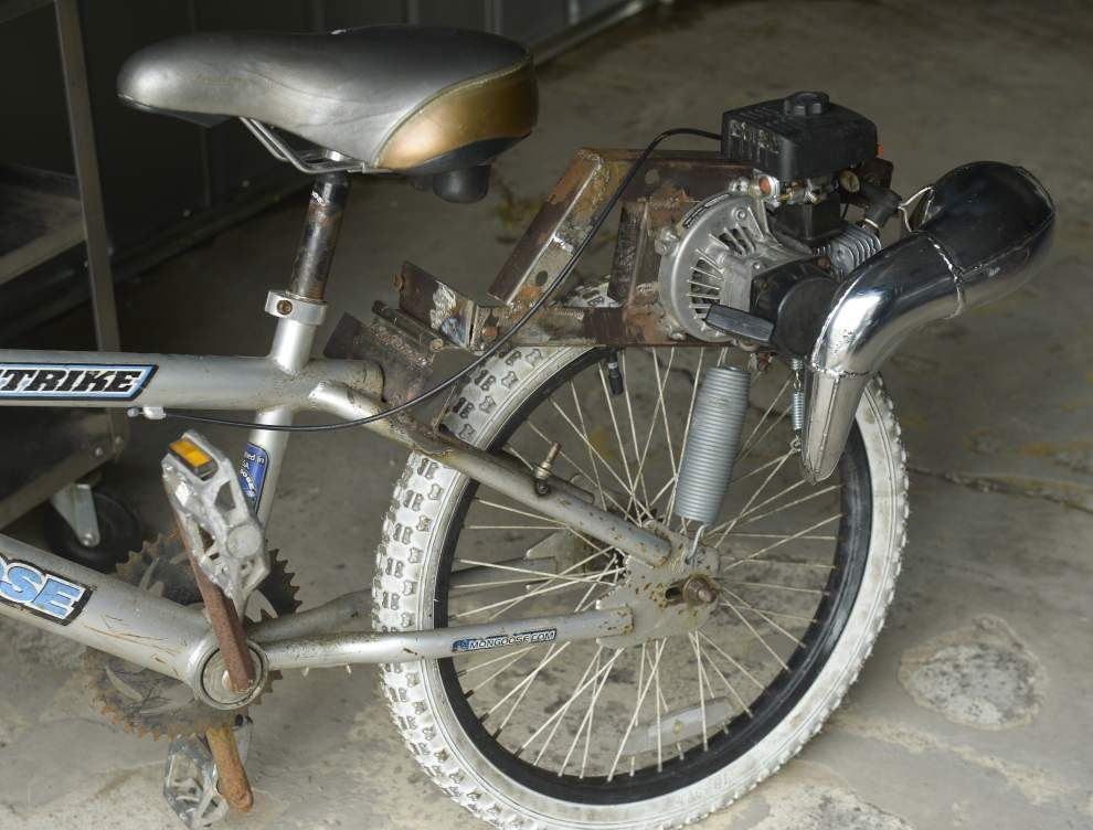 Man turns discarded materials into customized motorized bicycles _lowres