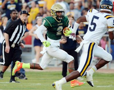 Jayrin Wilson is being recruited as a college defensive back, but he's making big contributions at running back for Acadiana _lowres